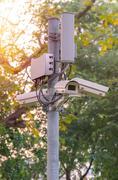 Security CCTV camera and urban video - stock photo