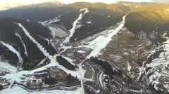 Aerial shot of ski resort Bukovel with snow covered slopes at spring Stock Footage