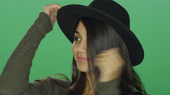 Young woman wearing a hat and being playful and posing Stock Footage
