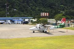 Planes local airlines at Seychelles International Airport on Mahe Island Stock Photos