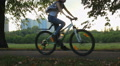 Energetic young guys go cycling in the park, love for speed, active lifestyle Footage