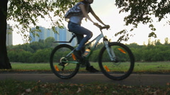 Energetic young guys go cycling in the park, love for speed, active lifestyle Stock Footage