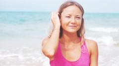 Closeup portrait. Woman doing meditation near the ocean beach. Yoga silhouette - stock footage