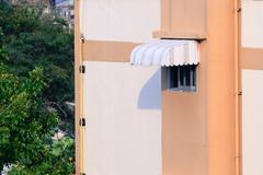 Rainproof awning of slide window on sunny day. - stock photo