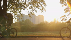 Cycling athletes training before marathon in municipal park, healthy lifestyle - stock footage