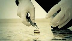 Crime scene CSI collecting bullet CU Stock Footage