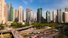 Shanghai aerial city view of Pudong skyscrapers, traffic and people on skywalk. Stock Footage