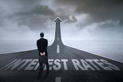 Interest rate and businessman on the road - stock photo