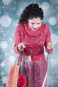 Woman opens shopping bags with winter background Stock Photos