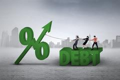 Workers pulling percentage sign of debt - stock photo