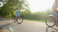 Many adults and children cycling in municipal park, people enjoying active rest Stock Footage