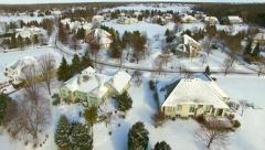Winter flyover of wealthy suburban neighborhood homes Stock Footage