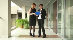 Two businesswomen discussing a contract Stock Footage