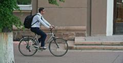 Office Worker Riding Bike Stock Footage