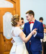 Bride and groom dancing the first dance at the wedding ceremony Stock Photos