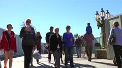 People walking on boardwalk. Stock Footage