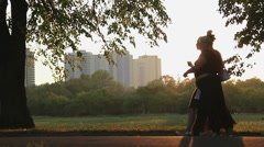 Overweight woman strolling in park, health problems due to obesity, overeating Stock Footage
