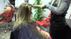 Hairdresser do hairstyle for female and woman under hair dryer machine. 4K Stock Footage