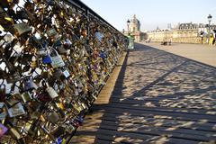 Lovers have locked thousands of locks to the Pont des Arts bridge in Paris. T Stock Photos
