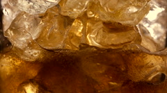 Refreshing Brown Soda with Ice cubes and bubbles Stock Footage