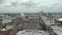 4K Aerial view Manchester crowded downtown rainy day English architecture emblem Stock Footage
