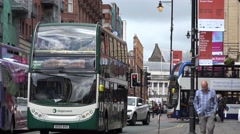 4K People commute public transportation double decker bus Manchester town day UK Stock Footage