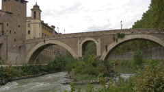 Fabricius Bridge over Tiber river and Chiesa di San Giovanni Calibita in Rome Stock Footage