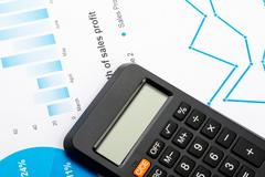Financial graphs and charts analysis with calculator - stock photo