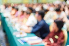 Blurred people in seminar room - stock photo
