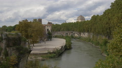 Beautiful view of Isola Tiberina and the tower of Tempio Maggiore di Roma Stock Footage