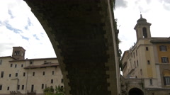 View under Ponte Fabricio and Chiesa di San Giovanni in Rome Stock Footage