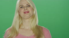 Beautiful blonde woman laughs and throws her hair back and starts dancing - stock footage