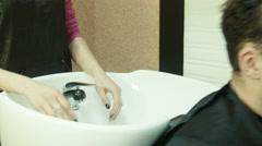 Man in beauty salon, washing head Stock Footage