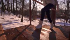 Young woman in silver winter boots walking upstairs. Slow motion outdoor video Stock Footage