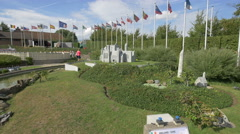 Waving flags next to the scale models displayed at the Mini-Europe, Brussels Stock Footage