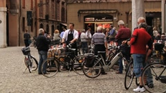 People talk at the square (Piazza Grande) in Modena, Italy. Stock Footage