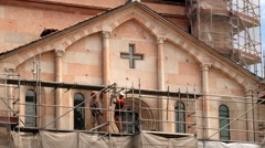 People do restoration work the church facade at Piazza Grande in Modena, Italy. Stock Footage