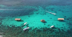 4K AERIAL PAN SHOT OF LOCAL BOAT IN THE DEEP BLUE OCEAN Stock Footage