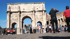 Tourists visiting the Arch of Constantine and the Colosseum Stock Footage