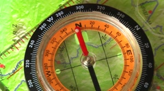 magnetic needle rotates in the compass - stock footage