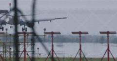 4k plane airport aeroplane sky zoom landing Stock Footage