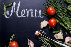 Set of ingredients on blackboard background with free space for text. - stock photo