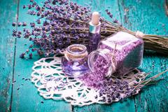 Aromatherapy oil and lavender, spa,  on a wooden background Stock Photos