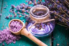 Aromatherapy oil and lavender, spa,  on a wooden background - stock photo