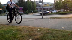 People riding bicycle in the sidewalk Stock Footage