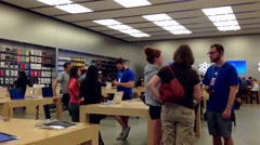 Motion of people buying new iphone inside Apple store Stock Footage
