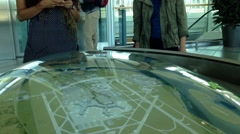 People checking map at YVR airport  in Vancouver BC Canada. - stock footage