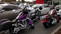 One side of car and motocycle parking outside of Scotiabank Stock Footage