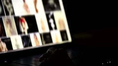 People browsing internet content about nude woman, focus on hand. Stock Footage