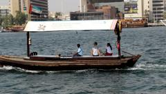 Tourist couple ride with driver at rented Abra boat, small wood vessel sail Stock Footage